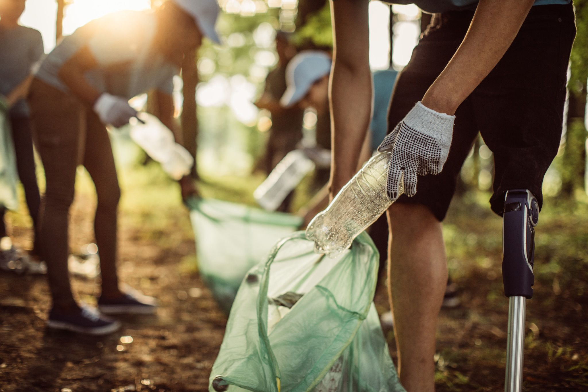 An image of volunteers picking up litter from a park.