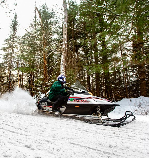 snowmobiling in winter