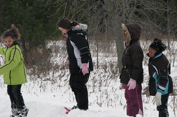 kids try snowshoeing at Potawatomi State Park
