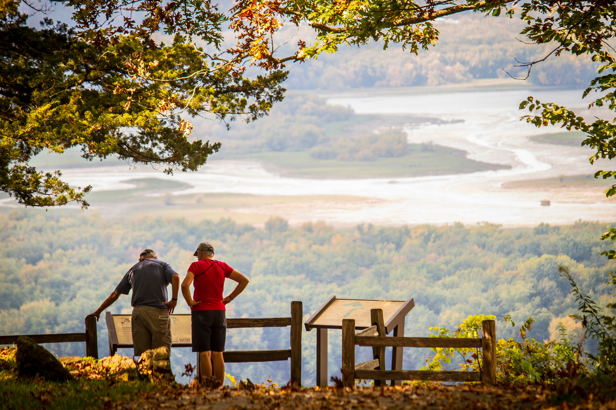 couple looking out over scenic overlook at Wyalusing State Park