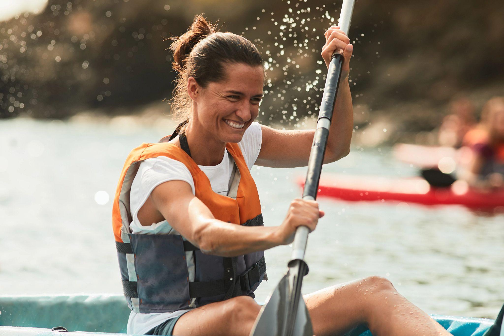 An image of a woman kayaking.