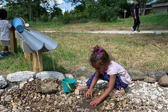 young girl plays in the outdoors