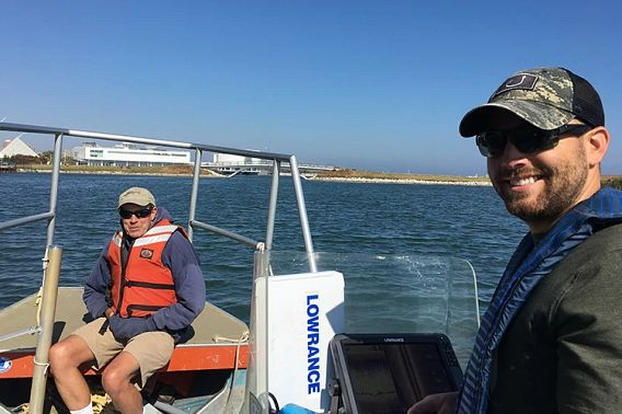 John Janssen and Brennan Dow in a boat during research