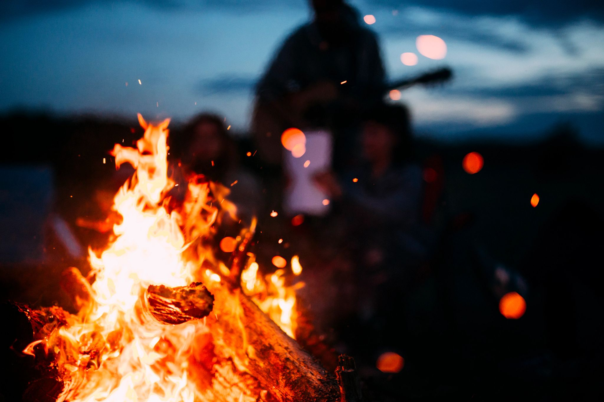 An image of a campfire at night.
