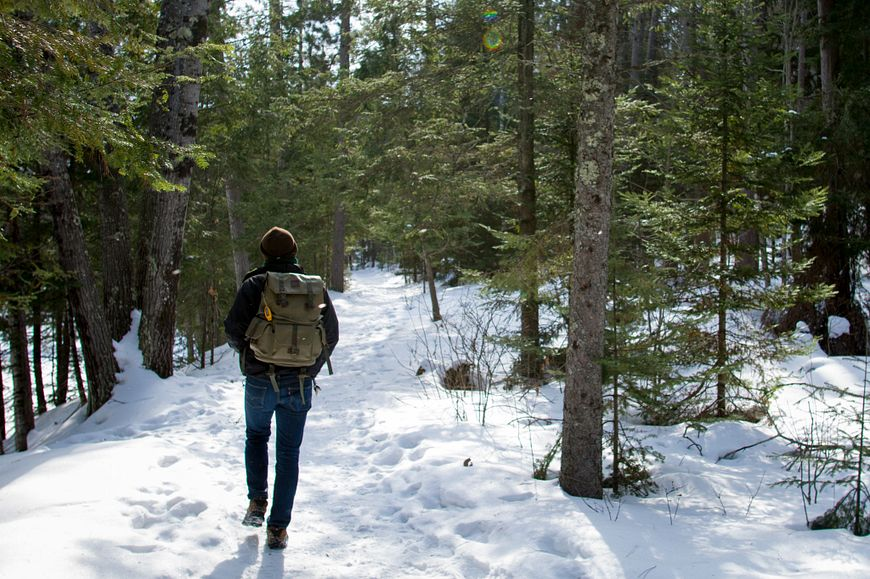 man hiking in winter at Copper Falls State Park