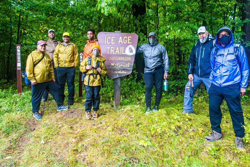 group of hikers at Ice Age Trail sign in Northwoods