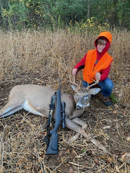 boy with harvested deer