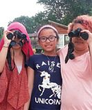 3 girls with binoculars