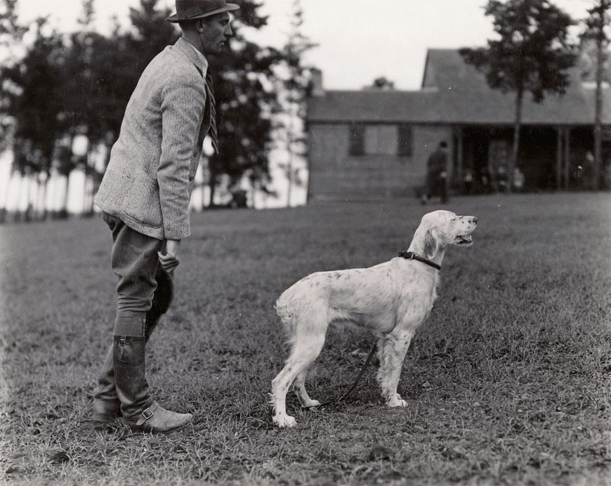 historic photo of a man with hunting dog