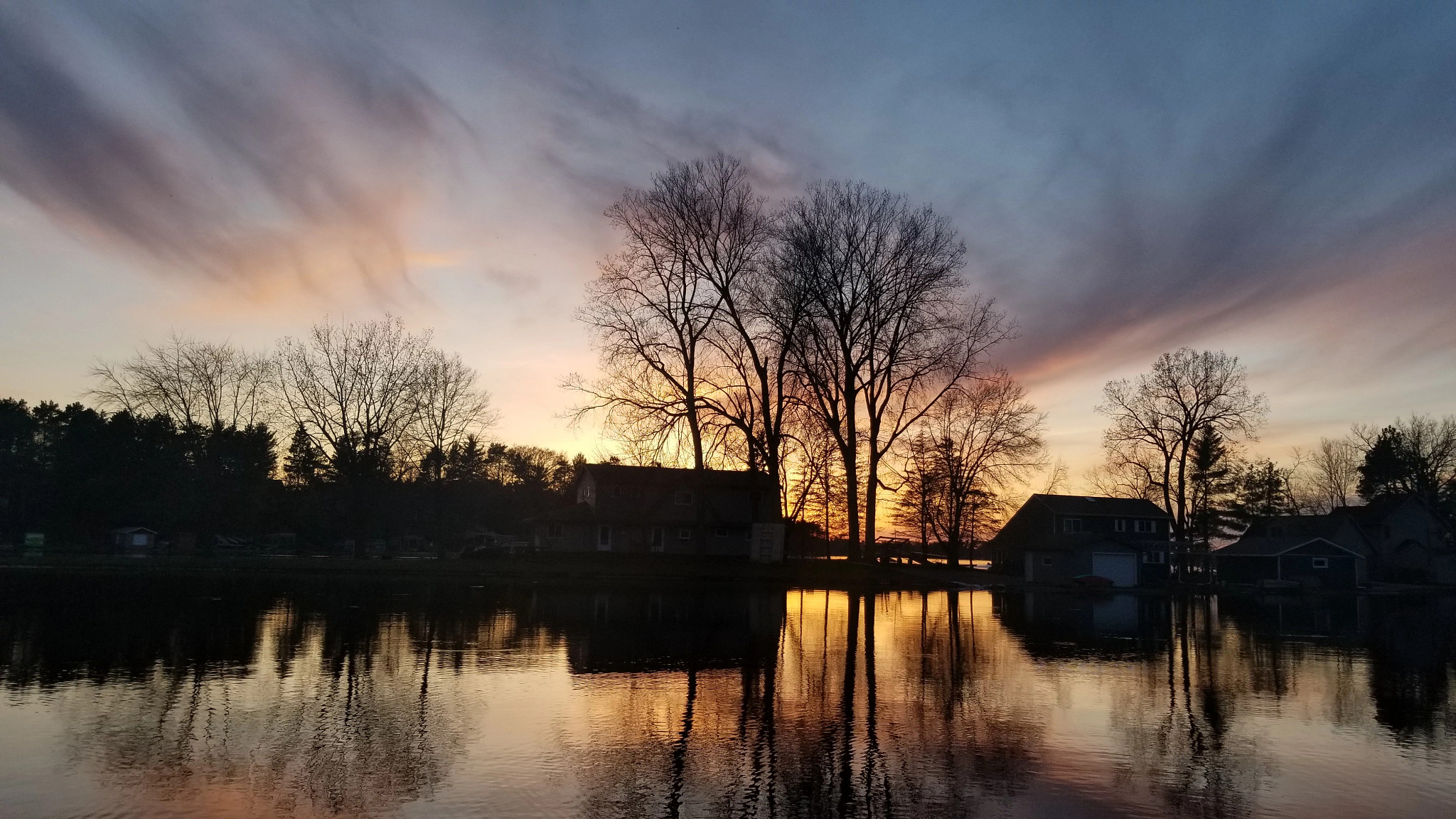 sunset over a calm lake