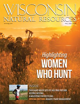 Fall magazine cover with woman shooting hunting bow in glowing sunlight