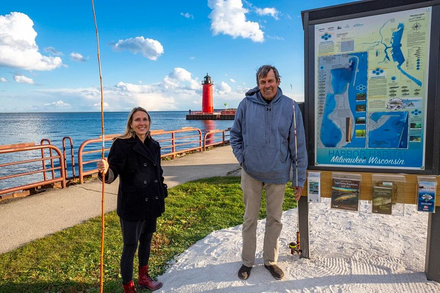 Kim Beckmann and John Janssen by maps signage on Milwaukee shore