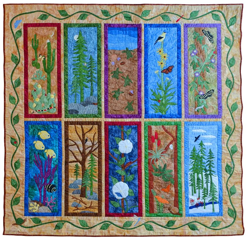 Intricately stitched nature quilt with 10 panels