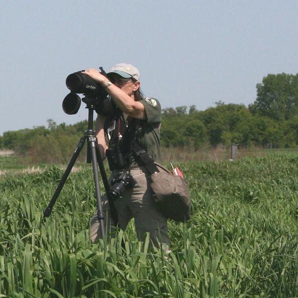 Karen Etter Hale looking through scope