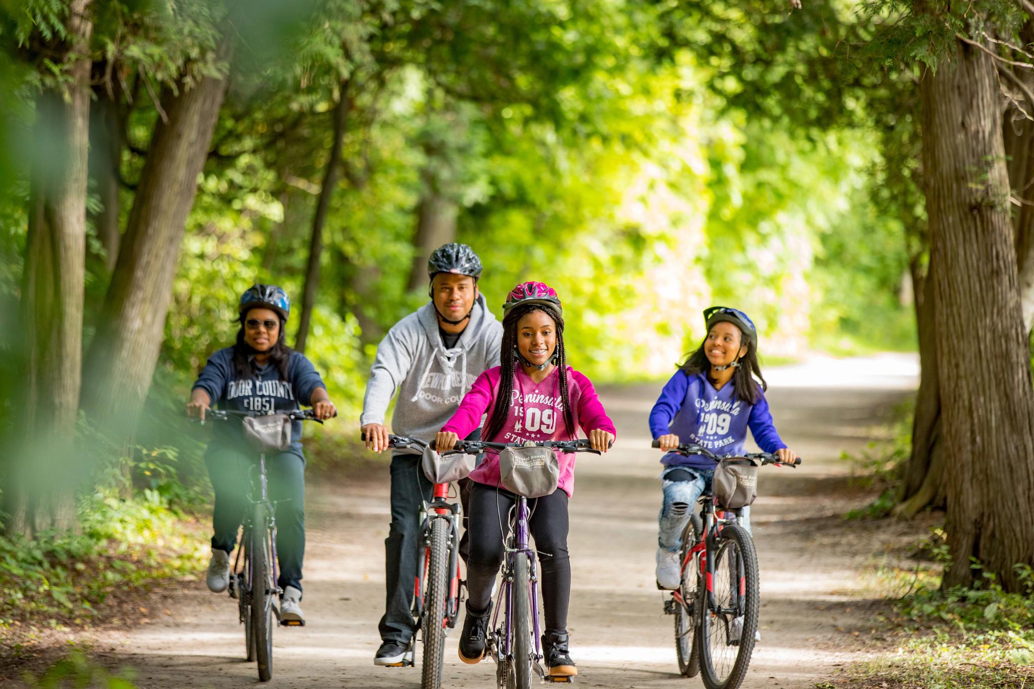 family enjoying a bike ride at Peninsula State Park
