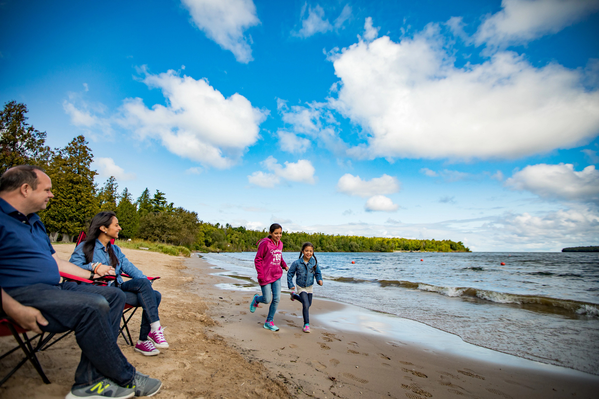 family playing on beach at Peninsula State Park