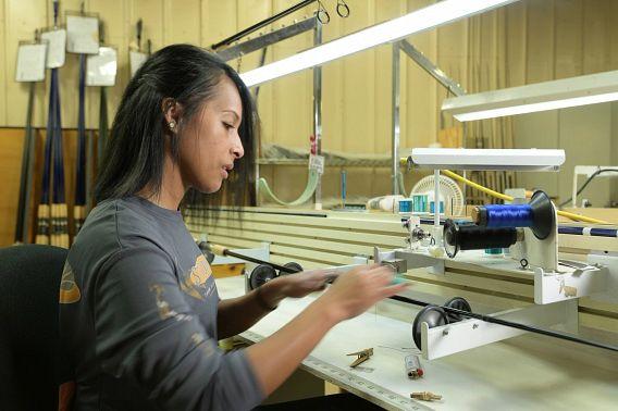 Woman operating a fishing rod machine