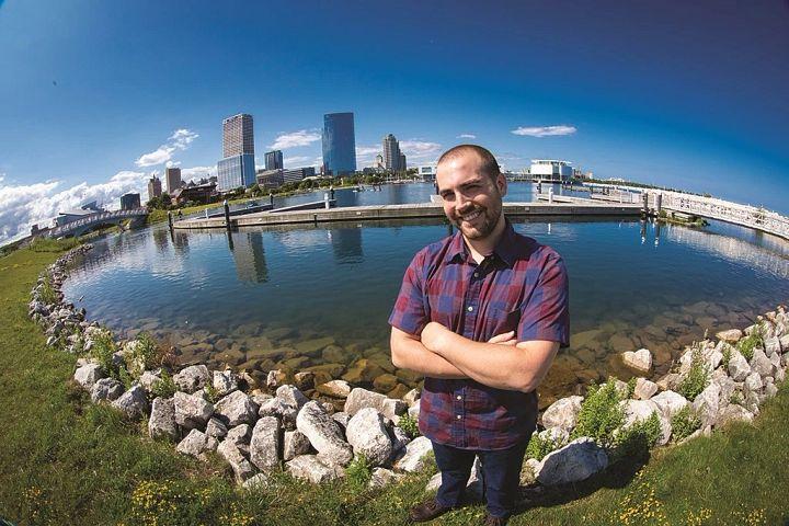 Brennan Dow standing on Milwaukee shore