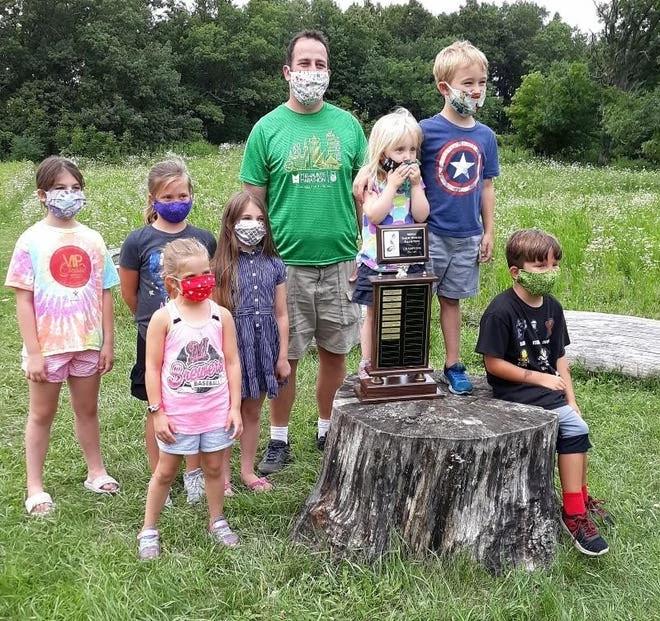 Menomonee Falls kindergarten teacher Peter Dargatz and his students, champion garlic mustard-pulling champions, are recent winners of the 2021 Invader Crusader Award.