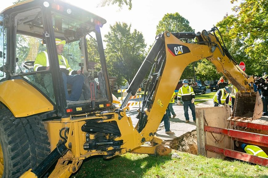 backhoe digging to remove a lead service line