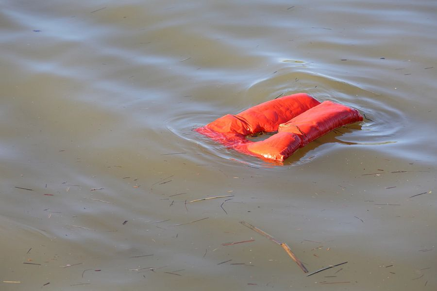 An overboard lifejacket drifting on the water