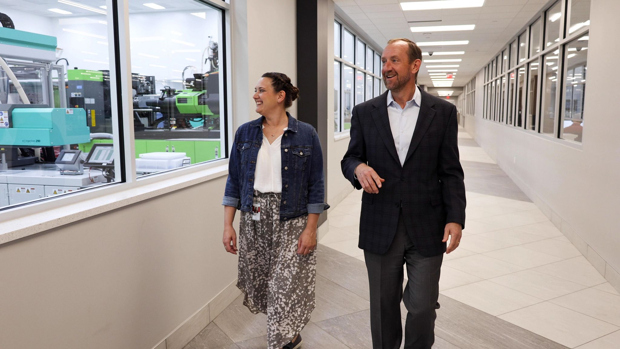 An image of two people walking in the Phillips-Medisize, St. Croix Meadows manufacturing facility